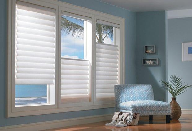 Custom cut white blinds on a beach house.