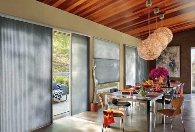 Window coverings in gray for sliding glass doors.