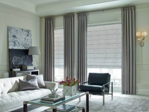 Modern living room with custom window coverings and draperies.
