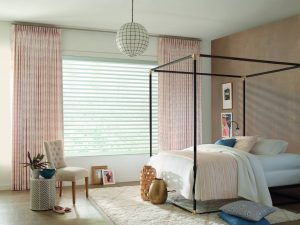 Bedroom with custom draperies and sonnette blinds.