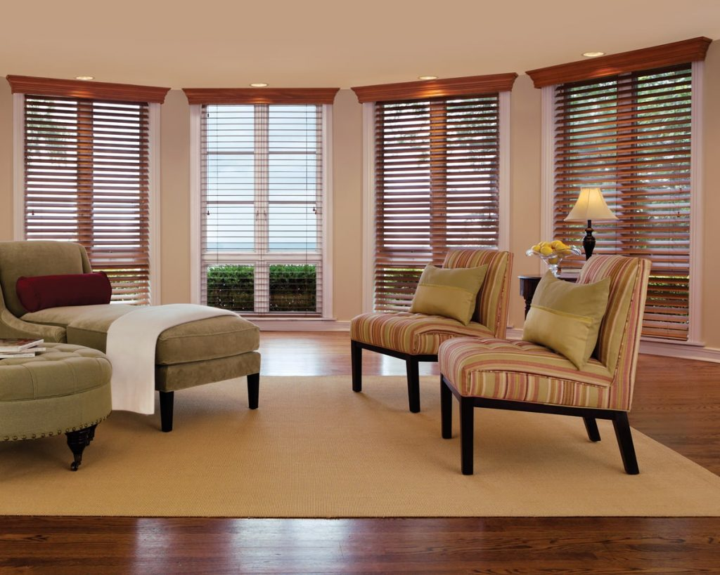 Living room with custom wood blinds for maximum privacy and light control.