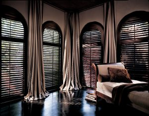 Elegant dark wood blinds custom fit to any size and shape window.