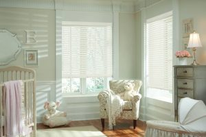 Ultra thin white wood blinds in a nursery.