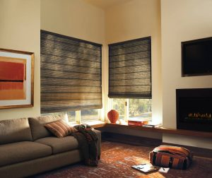 Charcoal roman shades in a modern living room.