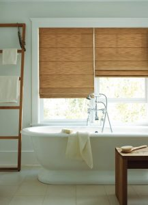 Roman shades in a wash room for complete, elegant privacy.