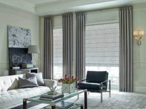 Modern, elegant roman shades in a living area.