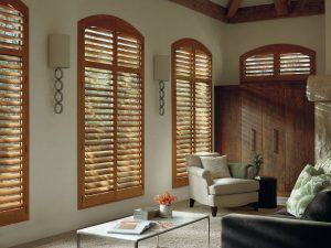 Tall wood shutters to control the light in a reading room.