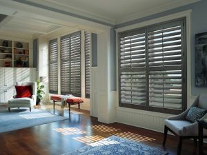 Custom wood shutters on a living room in Portland.